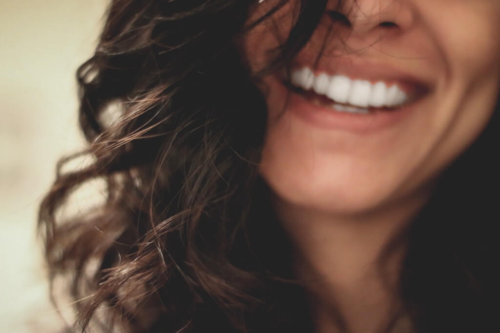 japanese skincare routine happy smiling woman wavy hair teeth smile