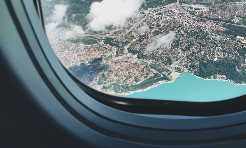 japanese packing trends tips tricks airplane window tropical europe from above plane vacation travel jetset wanderlust