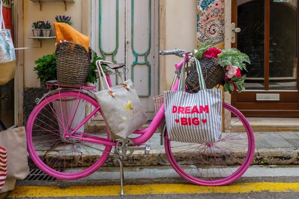 Eco-Friendly Shopping at Tare pink bicycle bike basket flowers provincial french sustainable travel shopping bags