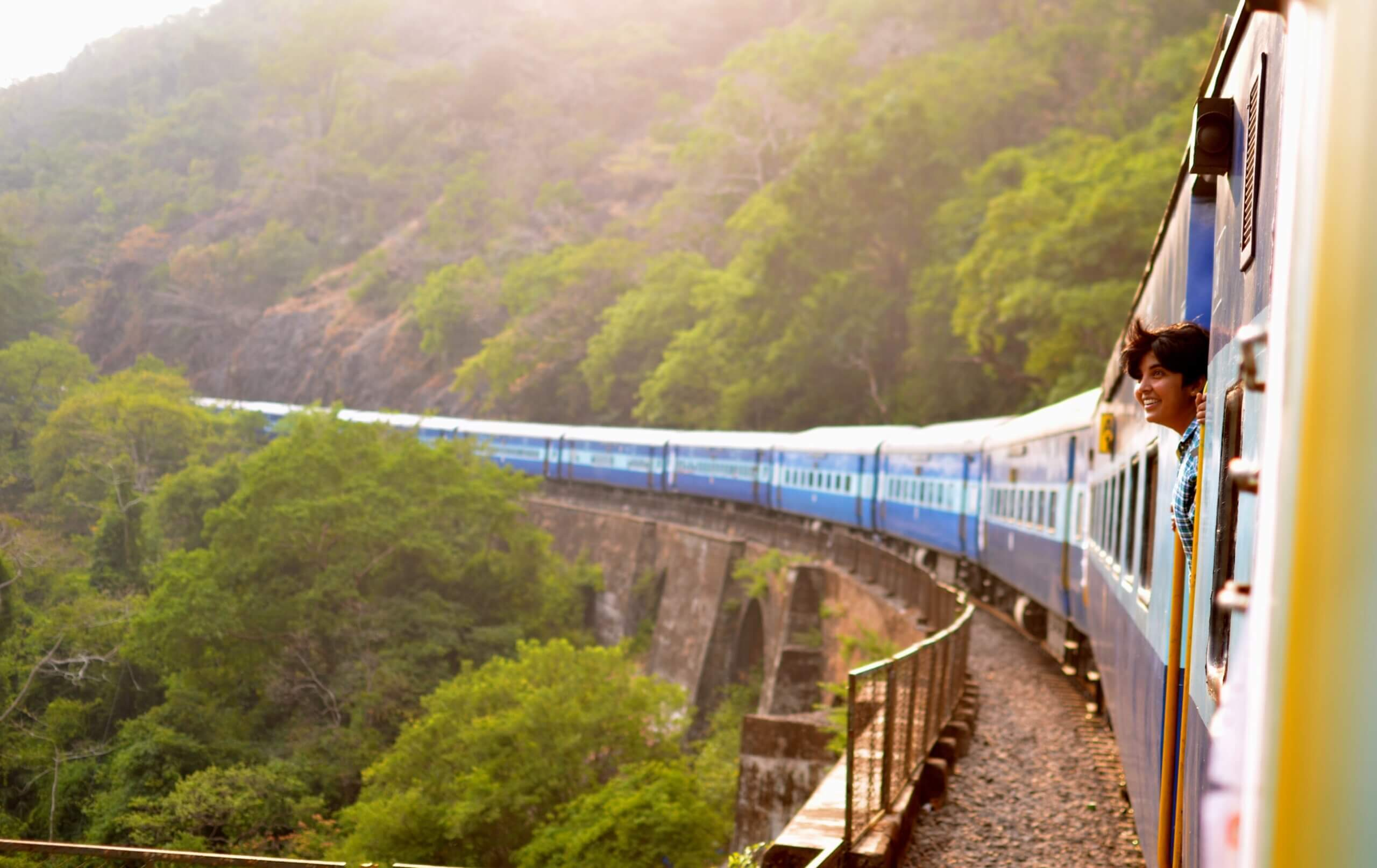 goa india woman on train beautiful view happy joy travel wanderlust locomotive mountains forest