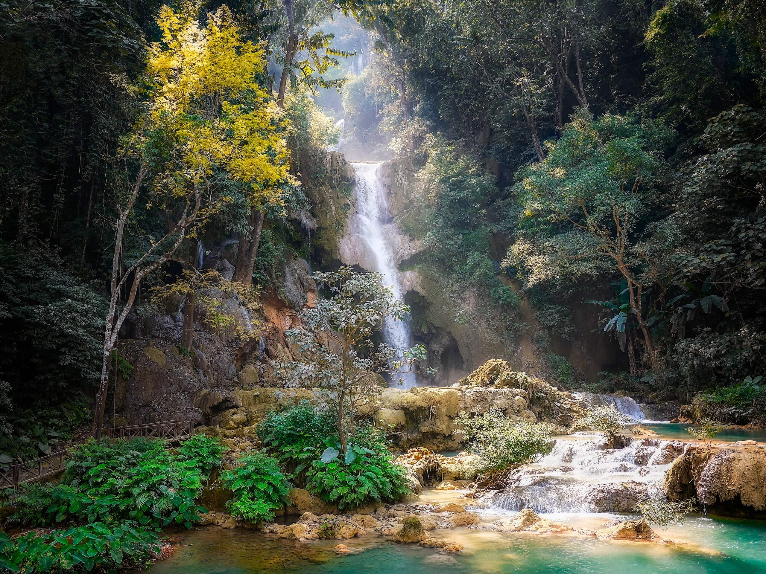 tropical forest Laos asia waterfall oasis paradise trees rocks boulders nature outdoors explore travel
